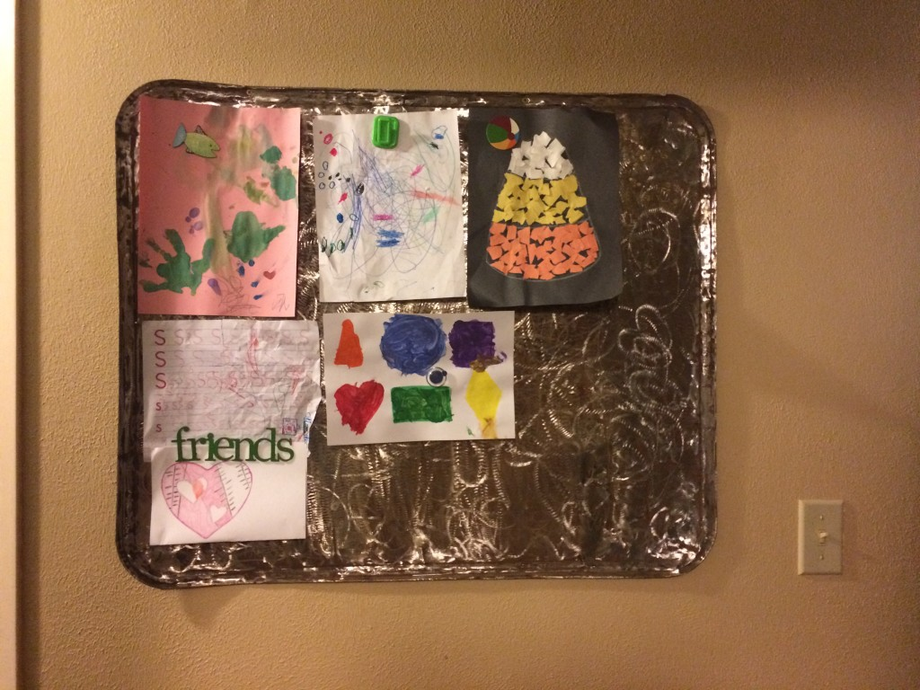 Distressed Metal: Magnetic Children's Art Display Board   A Domestic Wildflower click through to read this helpful and thorough tutorial for how to take junk metal and make a beautiful display board!
