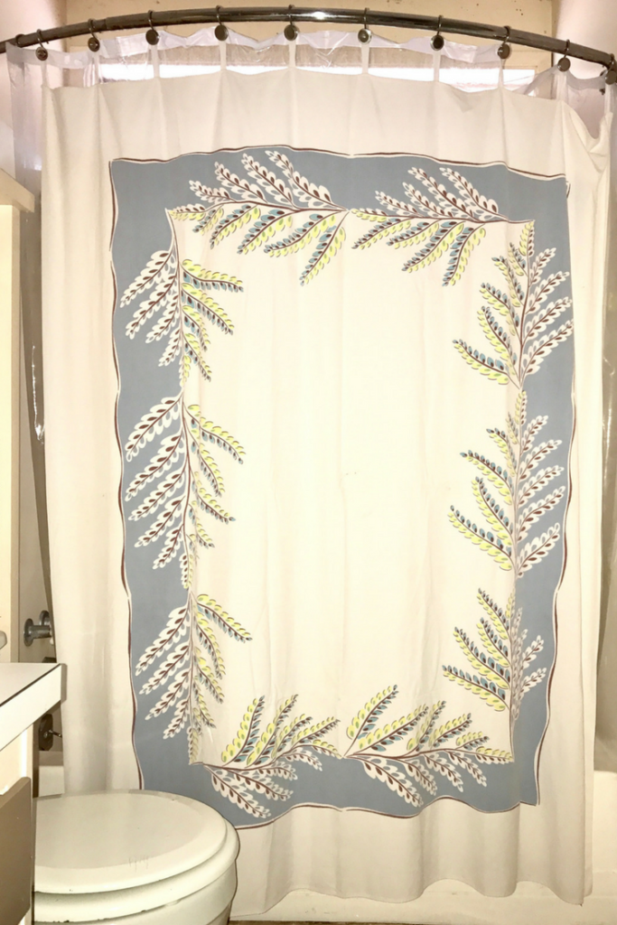 How to Sew a Shower Curtain with a Vintage Tablecloth | This farmhouse style DIY sewing hack shows you exactly how to craft a unique shower curtain from a vintage tablecloth. This is a super simple, easy sew tutorial and it is super clear! Click through to read it now!
